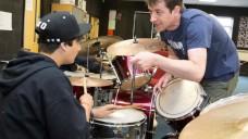 BCMG musician Ben Markland advises a young drummer