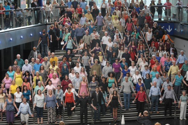 Crowd Out performers on the stairs at Millennium Point