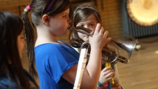 A young cornet player performs at Music Maze