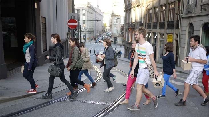A Folded Path participants carrying speakers